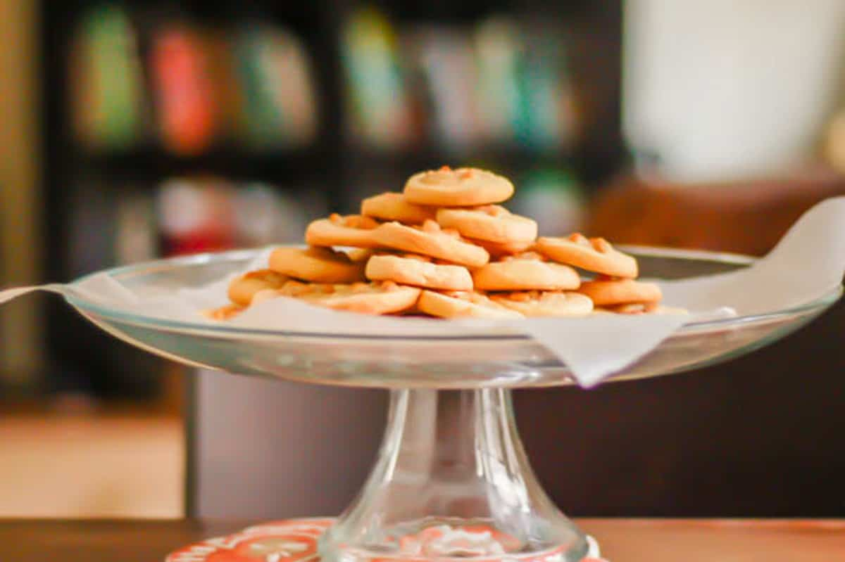 Rosemary Pine Nut Cookies on a cake stand