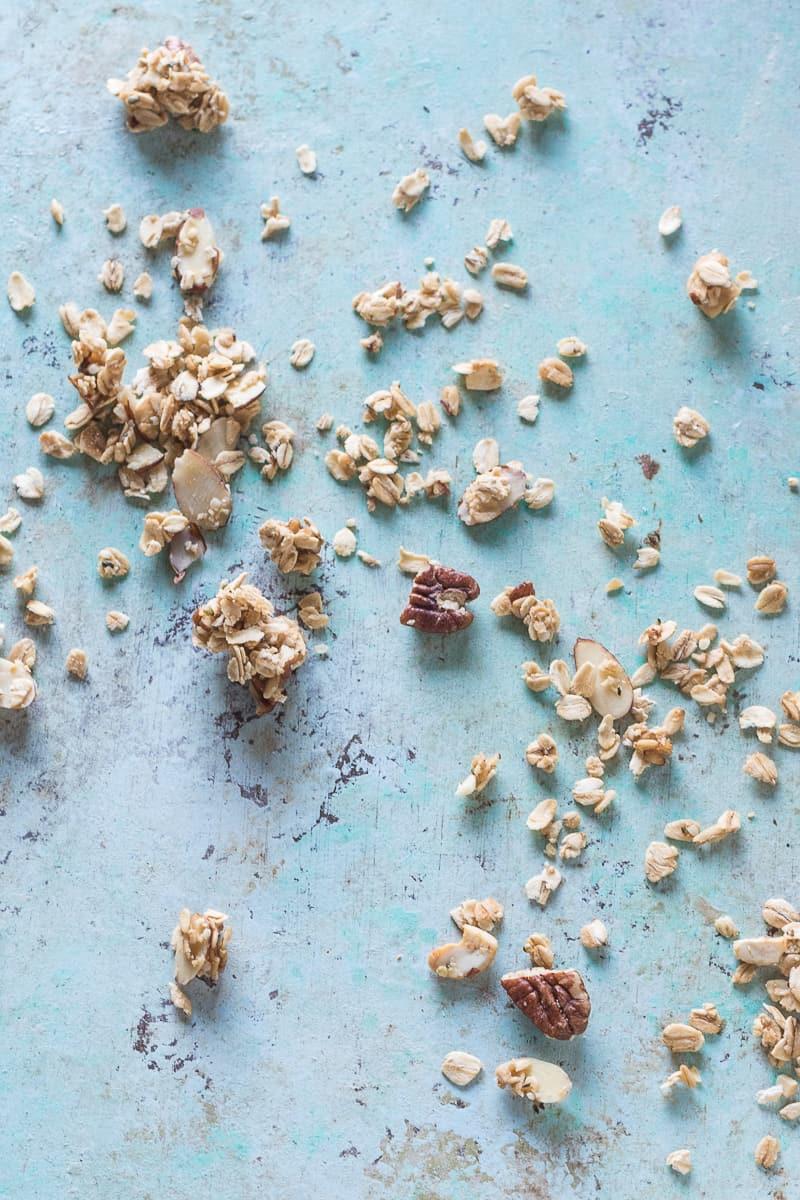 Maple Nut Granola strewn across a table, overhead view