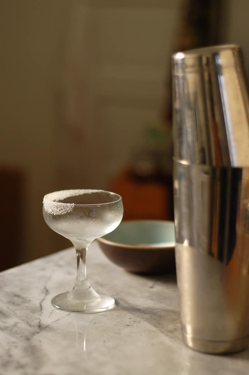 Coupe glass with a half-sugared rim