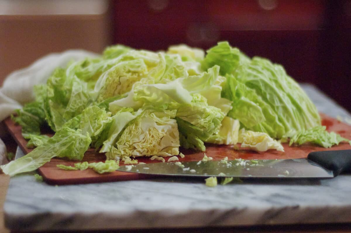 Thinly sliced savoy cabbage on a cutting board