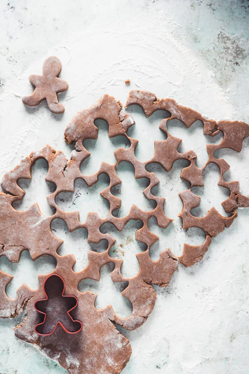 Gingerbread dough with gingerbread man shapes cut out