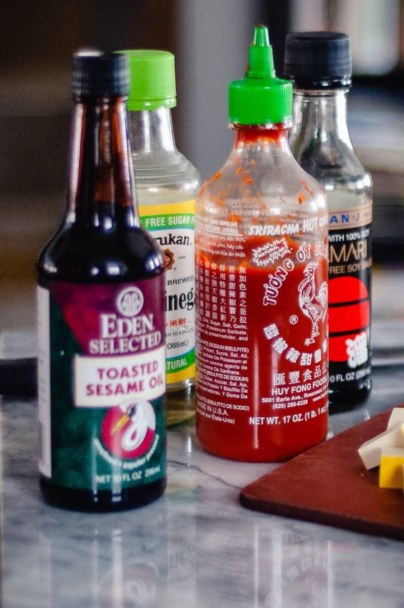 Sesame oil, sriracha, rice vinegar, tamari