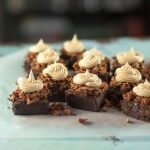 Peanut Butter Crunch Brownies. Fudgy brownies with a crisp layer of chocolate-peanut-butter feuilletine topped with a swirl of salted peanut butter buttercream. Salty, sweet, crispy, creamy, delicious! From Blossom to Stem | Because Delicious www.blossomtostem.net
