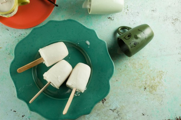 Vanilla Bean Coconut Popsicles. A rich, creamy, coconutty, vanilla-bean flecked frozen treat that's so simple to make. Low in sugar and dairy free. From Blossom to Stem | Because Delicious www.blossomtostem.net
