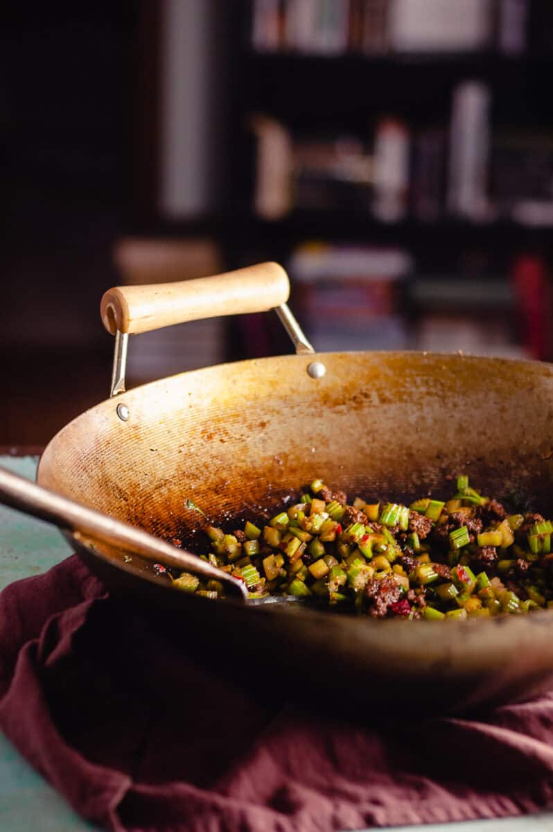 Sichuan send-the-rice-down chopped celery with beef in a wok