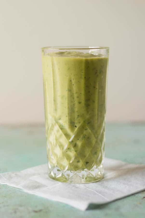 Pineapple Mango Ginger Green Smoothie. A bright green kale smoothie with tropical fruit, ginger, probiotics from kefir. A perfect way to start the day. From Blossom to Stem | Because Delicious | www.blossomtostem.net