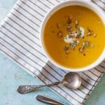 Roasted Heirloom Squash and Tart Apple Soup. A sweet and tart and savory fall soup with red kuri squash and tart apples topped with caramelized pepitas. Gluten free, vegetarian-friendly. From Blossom to Stem | Because Delicious | www.blossomtostem.net