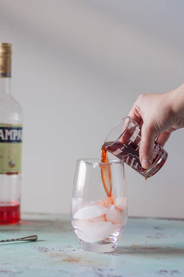Smoked Barrel-Aged Negroni (no barrel required). A classic Negroni cocktail gets instantly infused with smoky applewood in an ISI cream whipper. Science! From Blossom to Stem | Because Delicious | www.blossomtostem.net