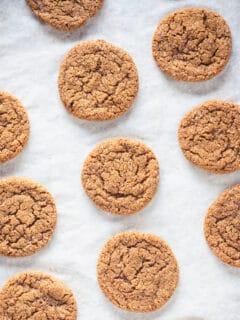 Chewy Citrus Molasses Spice Cookies on parchment paper
