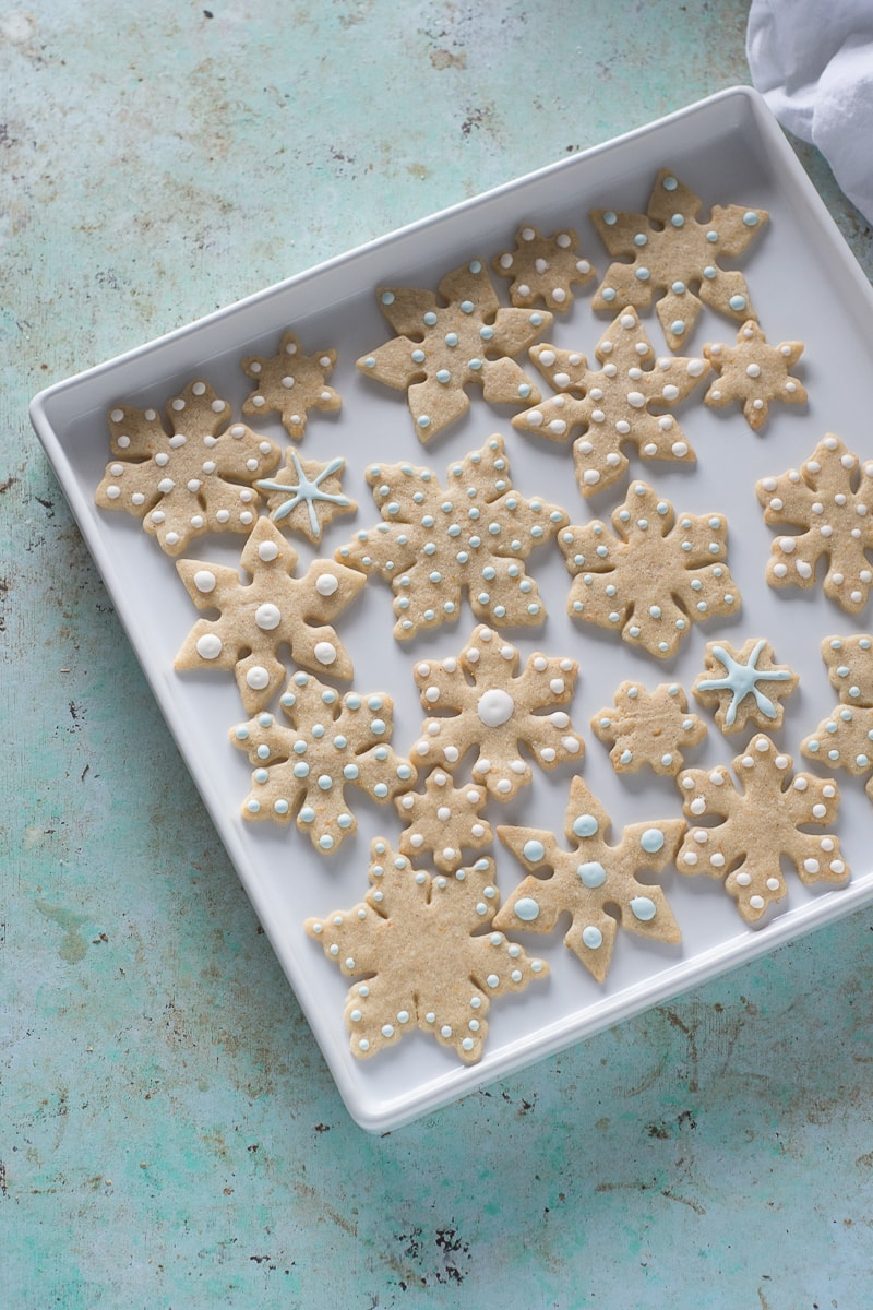 Orange Cardamom Snowflake Cookies. A crisp, fragrant citrusy holiday spice cookie, worthy of your prettiest cookie cutters.