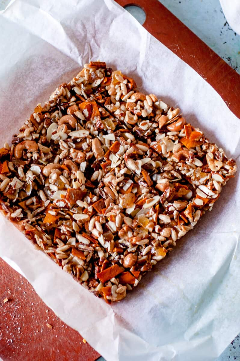 Homemade Kind bars, sliced on a piece of parchment paper