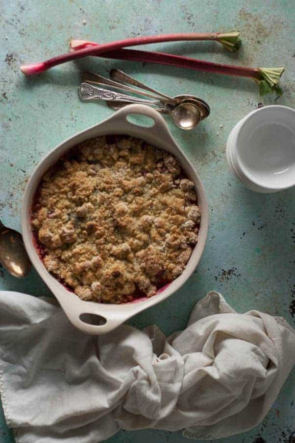 Rhubarb Crumble. Bright pink tart rhubarb tossed with sugar and orange zest slumped under a brown butter vanilla bean cookie-like lid. Rustic and homey baking at its best. From Blossom to Stem | Because Delicious | www.blossomtostem.net