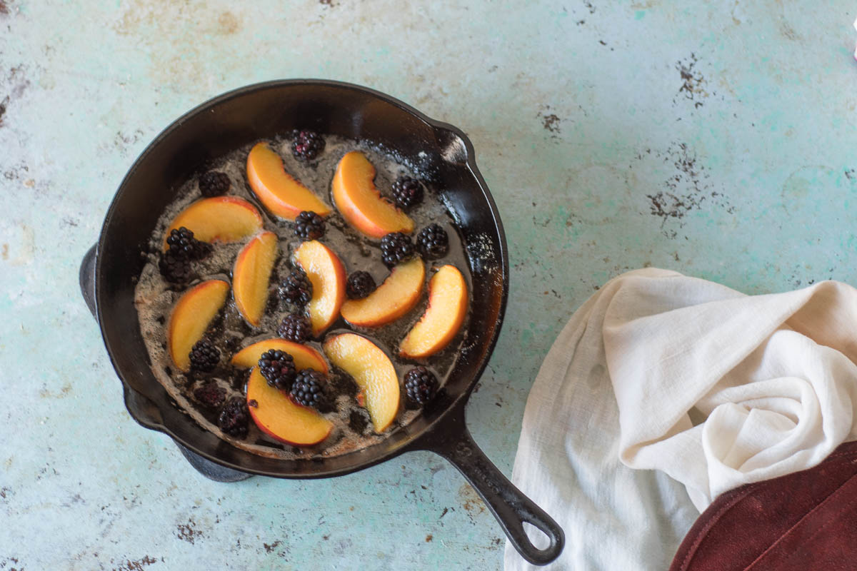 Blackberry Peach Dutch Baby. A puffy, golden oven pancake with berries and stone fruit. A simple sweet breakfast or brunch. From Blossom to Stem | Because Delicious | www.blossomtostem.net