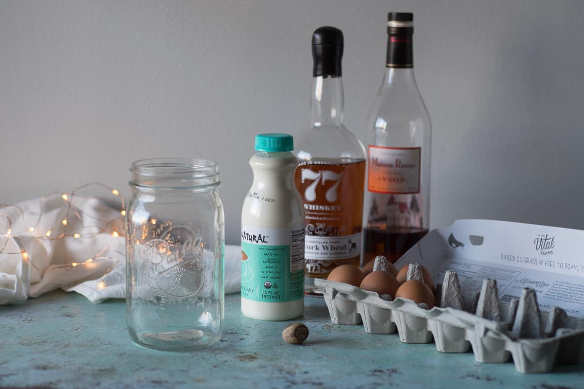 Mason jar, half and half, bourbon, brandy, eggs
