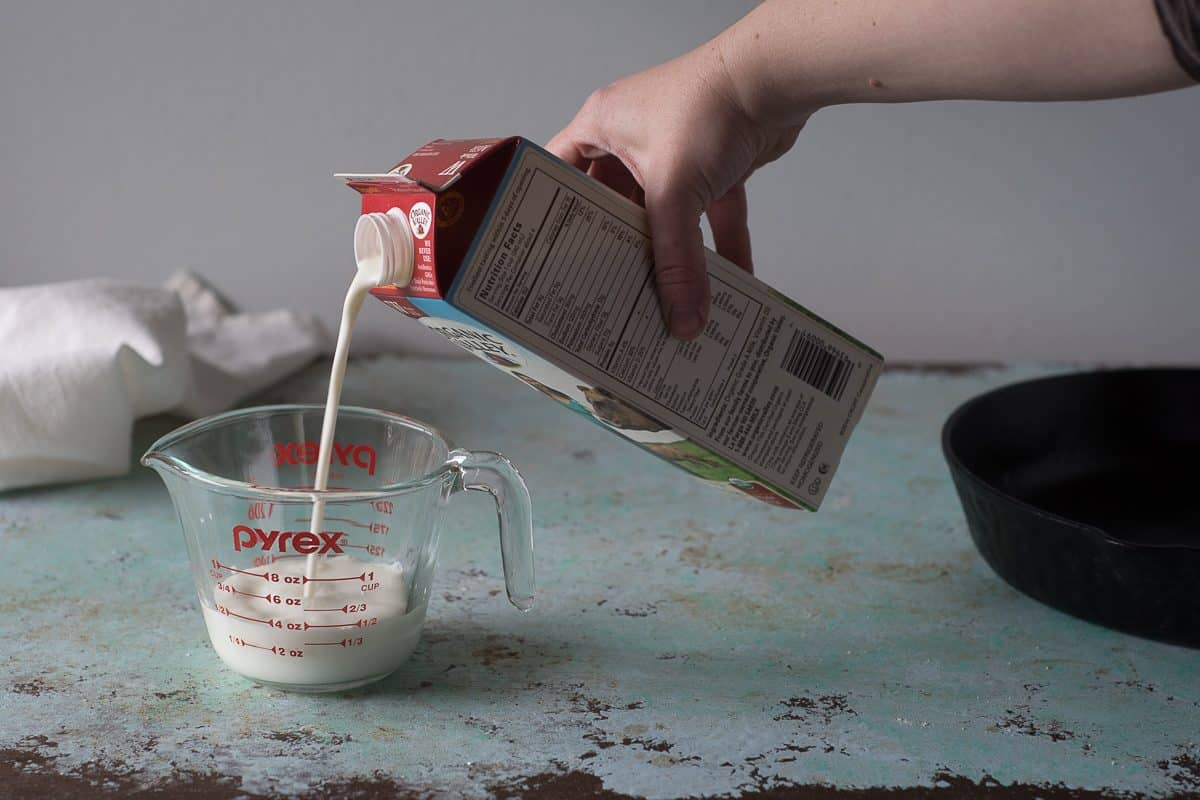 Pouring milk into a measuring cup