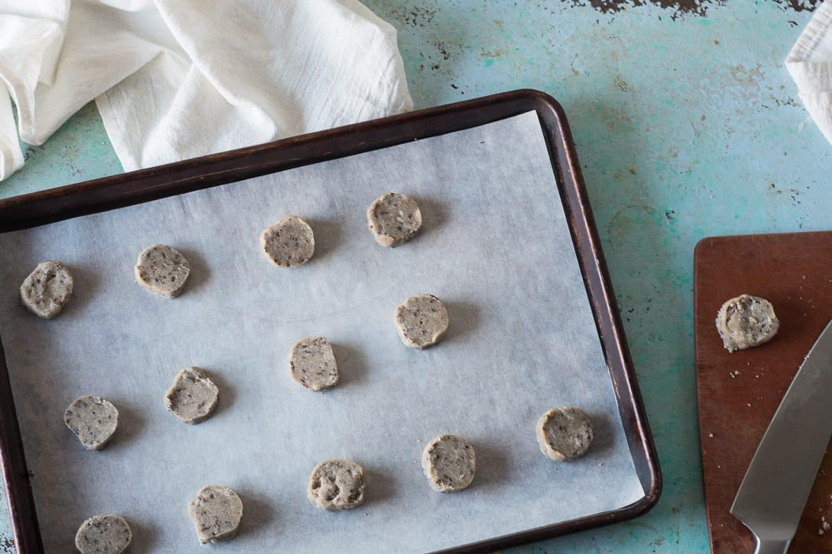 Unbaked Nibby Buckwheat Cookies on a baking sheet