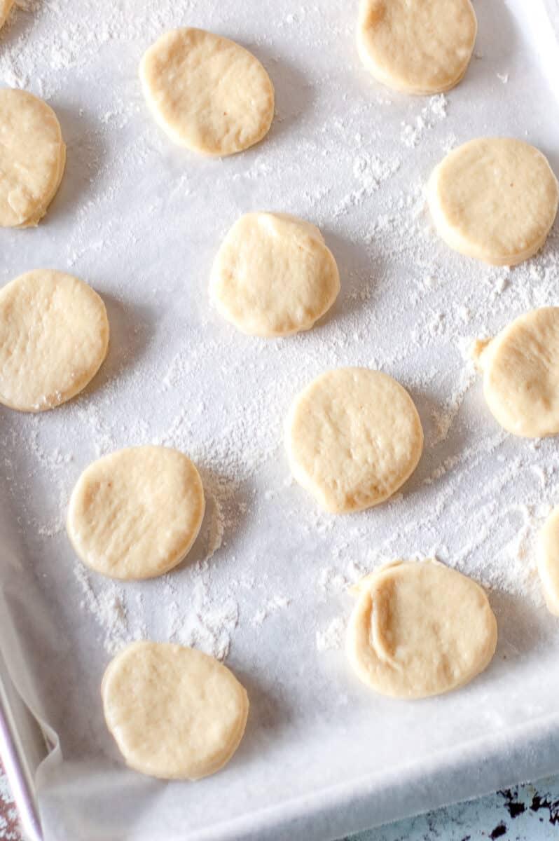 Cut out rounds of paczki dough