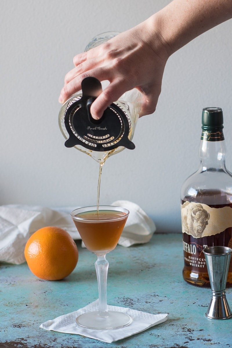 The Revolver, a bourbon cocktail with coffee liqueur and orange bitters. A spirit forward whiskey drink with subtle notes of coffee and citrus.