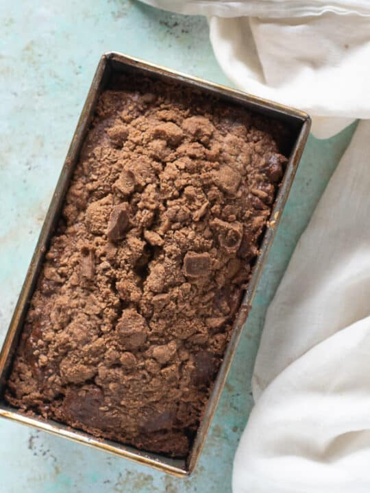 Streusel-topped Banana Bread with Chocolate and Pecans in a loaf pan
