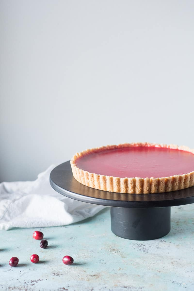 Cranberry Curd Tart on a cake stand