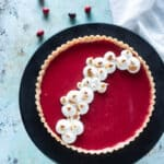 Cranberry Curd Tart with toasted meringe, vertical orientation