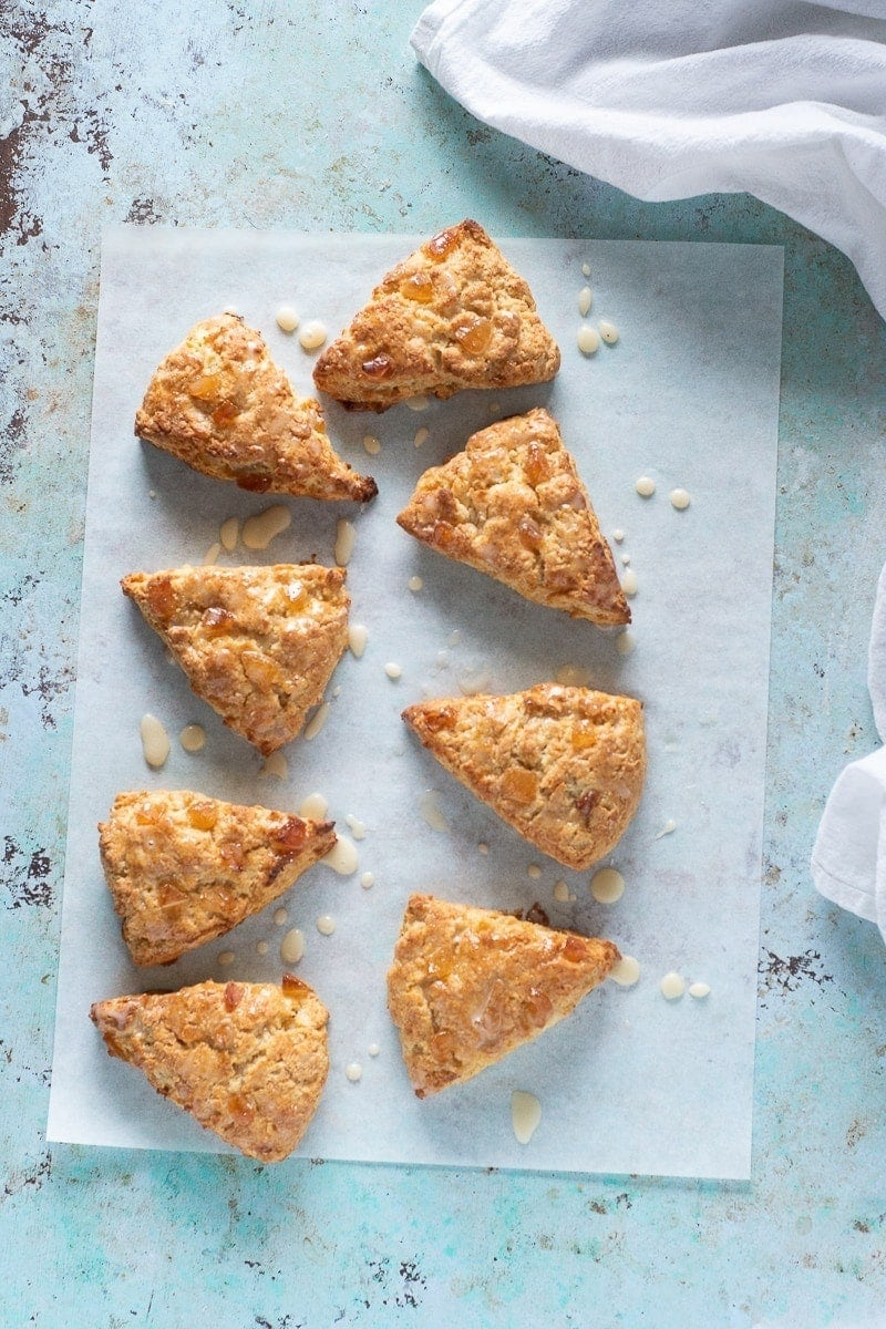 Orange Ginger Scones with Crème Fraîche Icing. American bakery-style scones flavored with orange zest and crystallized ginger. Perfect for a lazy weekend morning. Quick, easy, and delicious. #scones #breakfast #quickandeasy