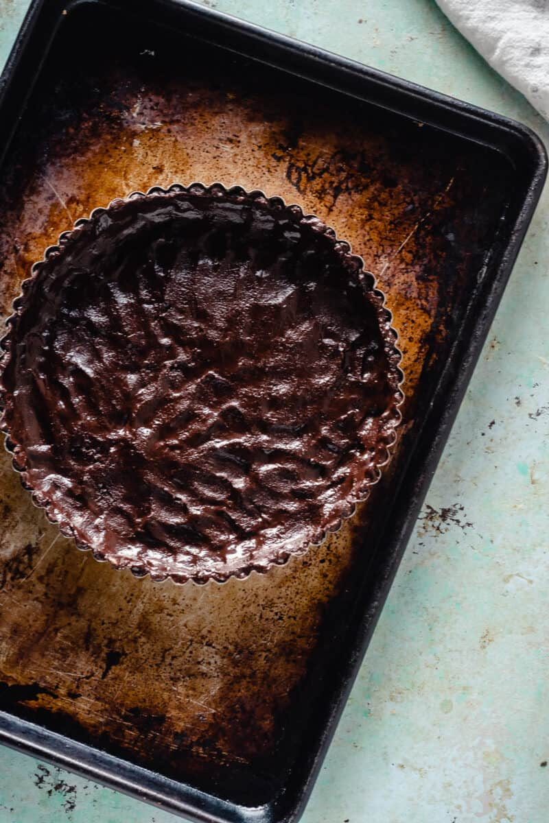 Chocolate tart crust, unbaked, on a sheet pan