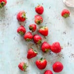 Strawberries strewn on a counter