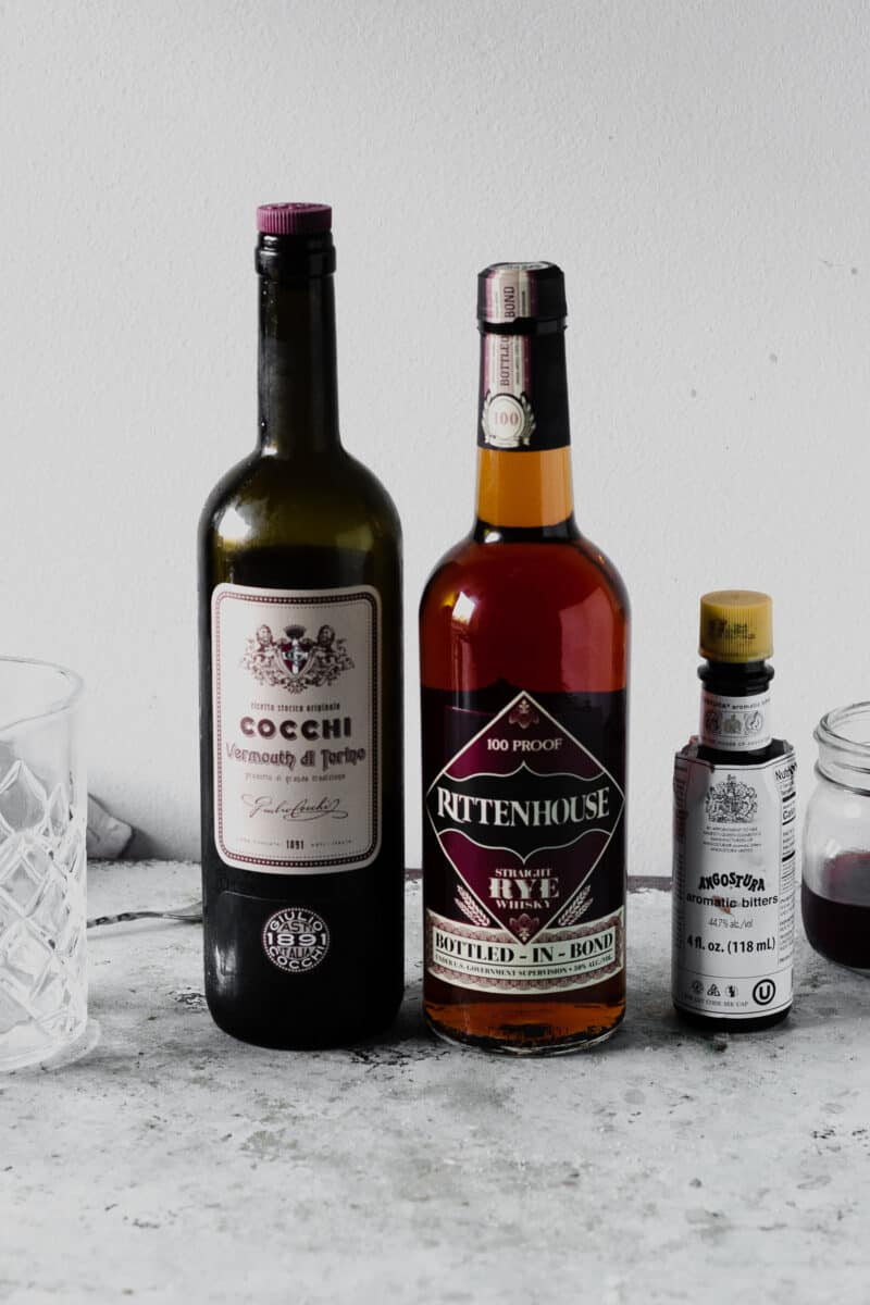 Bottles of sweet vermouth, rye, and angostura bitters