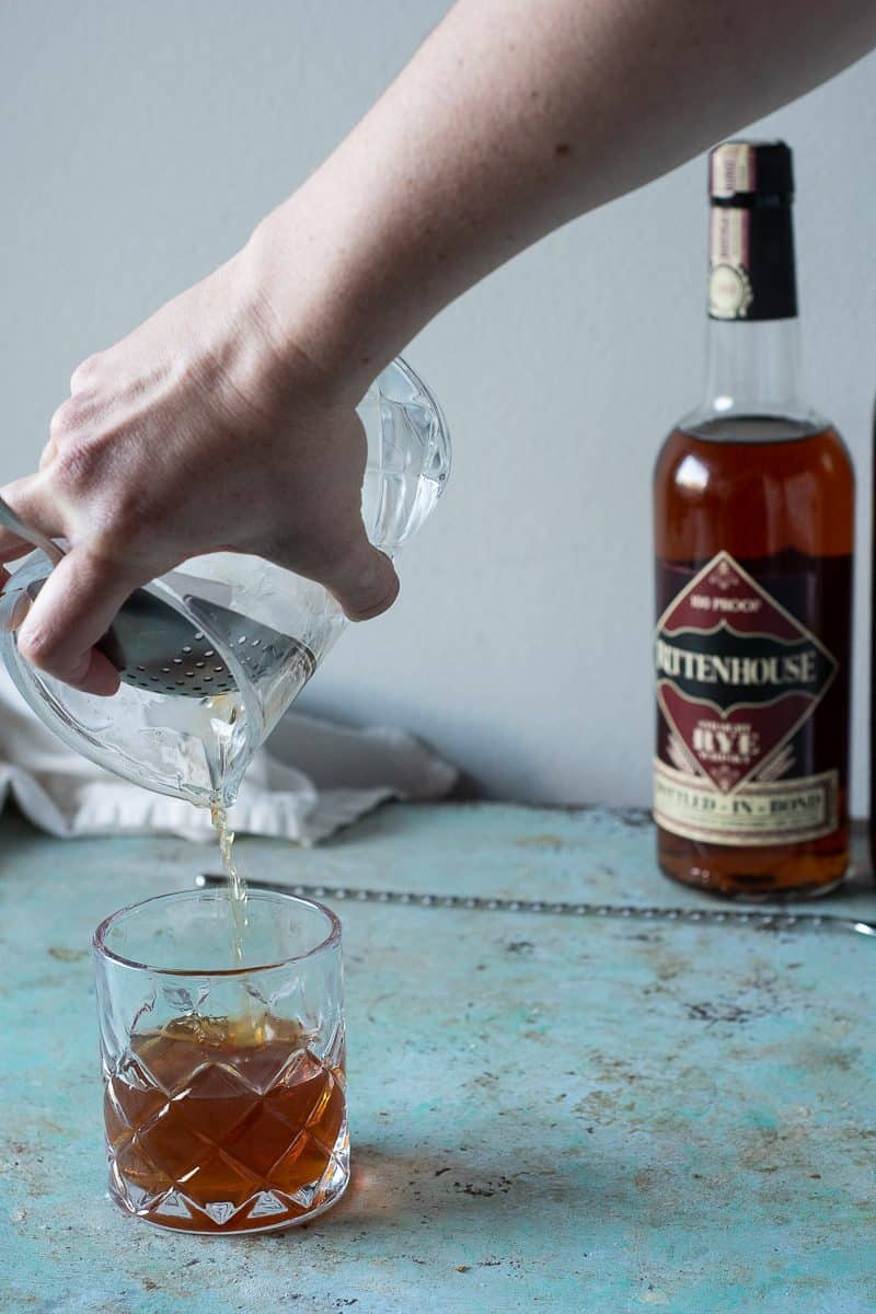 Straining a Manhattan into a cocktail glass