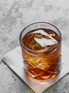 Manhattan cocktail in a rocks glass with a big ice cube