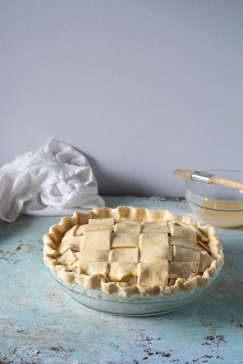 Unbaked apple pie, brushed with pie wash