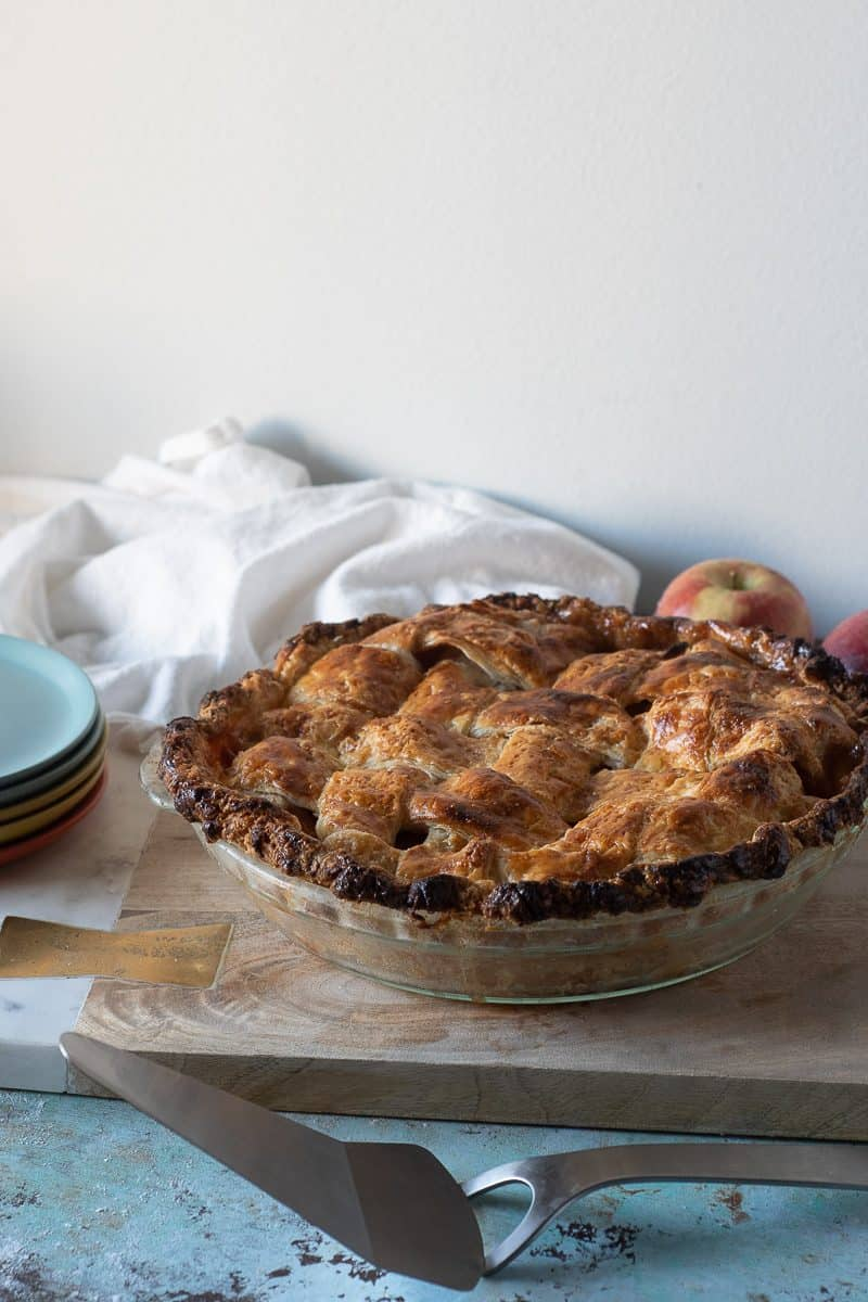 Whole apple pie, side view