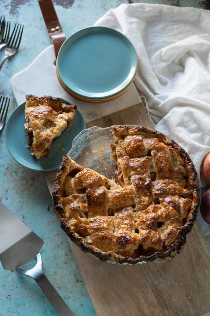 Apple pie with a slice removed, overhead view