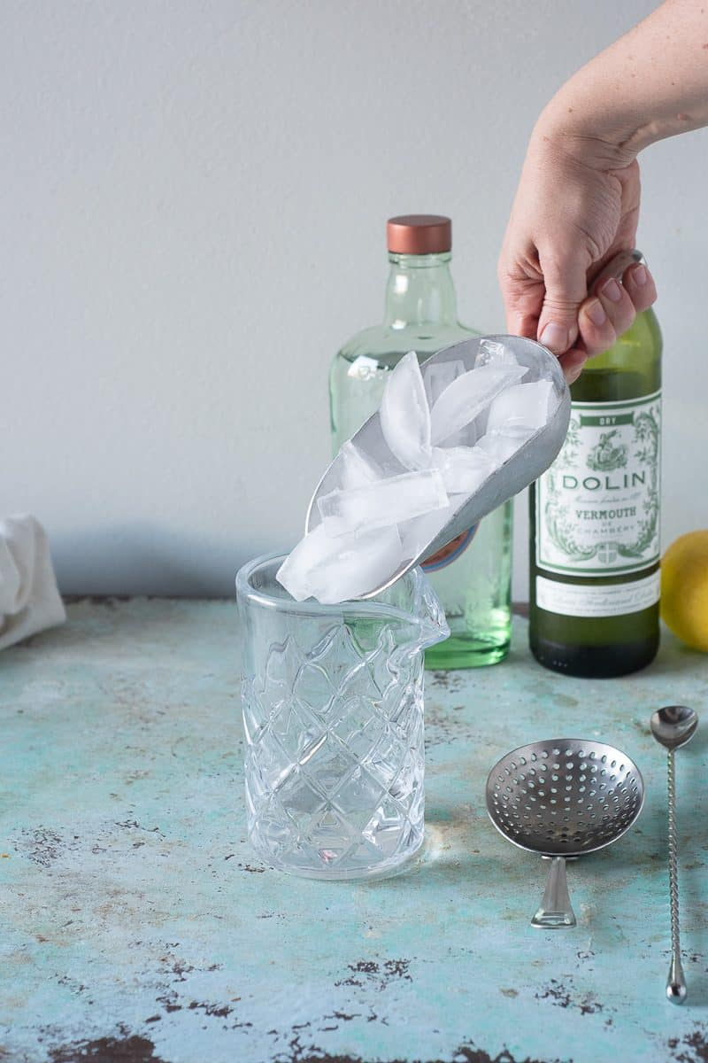 Adding ice to a mixing glass