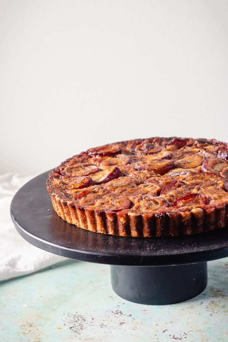 Plum custard tart, unsliced