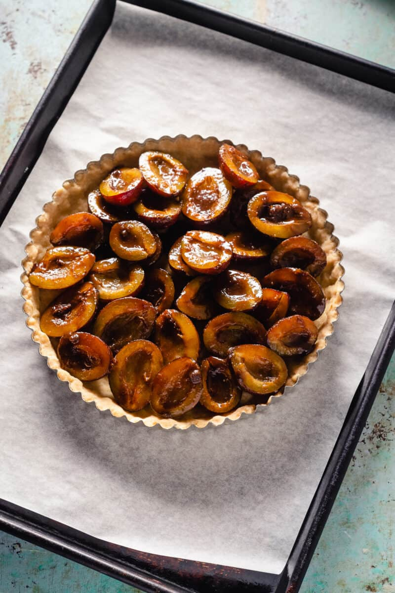 Plums arranged on a tart crust