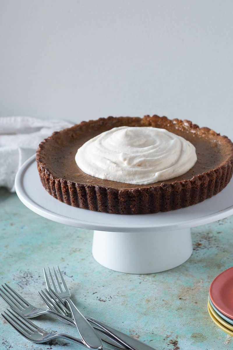 Caramel Pumpkin Tart with Gingersnap Crust, topped with whipped cream