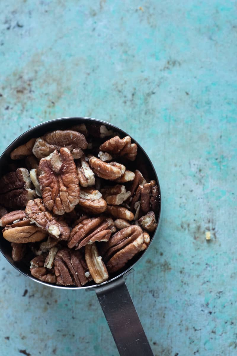 Pecans in a measuring cup