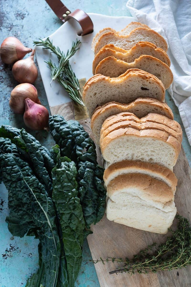 Kale, shallots, rosemary, and slices of bread