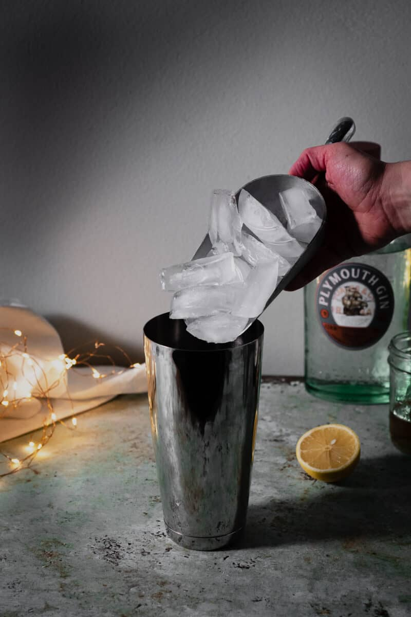 Scooping ice into a cocktail shaker