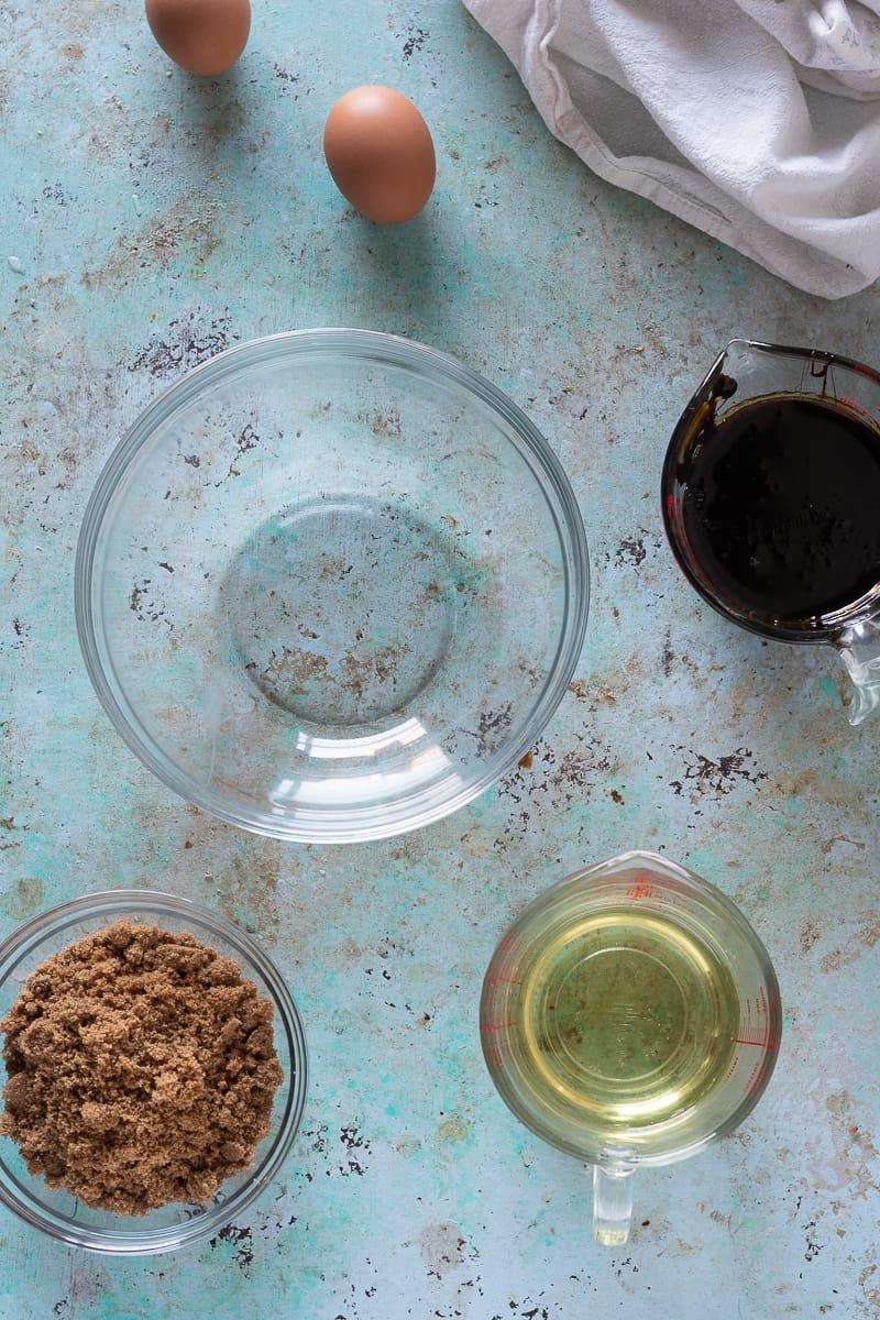 Eggs, molasses, safflower oil, dark brown sugar in bowls