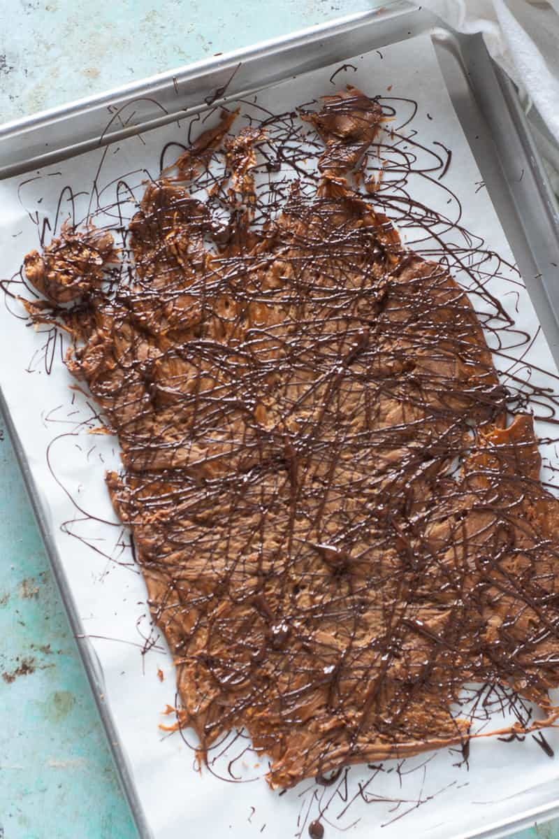 Chocolate drizzled over peanut butter brittle