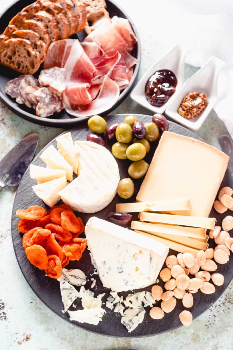 Cheese and charcuterie with olives, apricots, and almonds