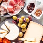Cheeses, meats, and accompaniments up close