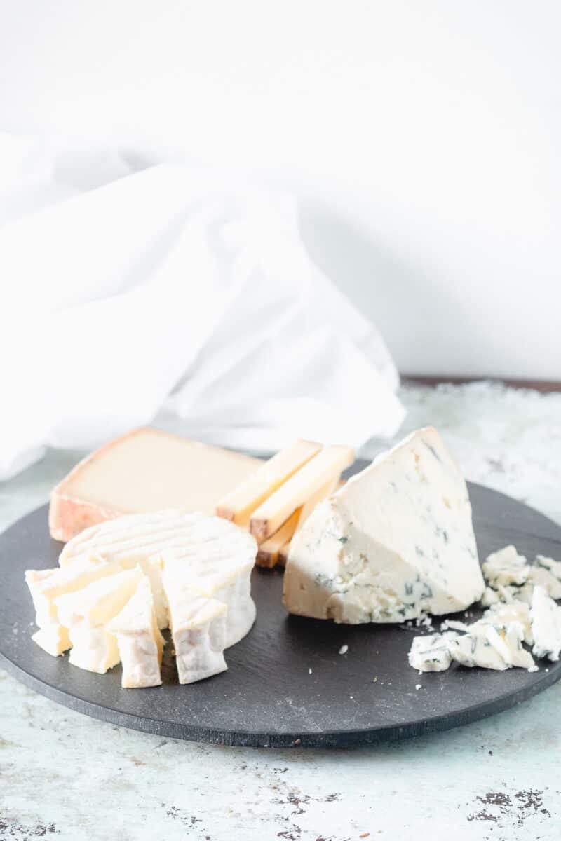 Sliced cheese on a slate board
