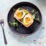 Ramen eggs on avocado toast overhead shot