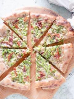 Asparagus Pizza, sliced on a peel