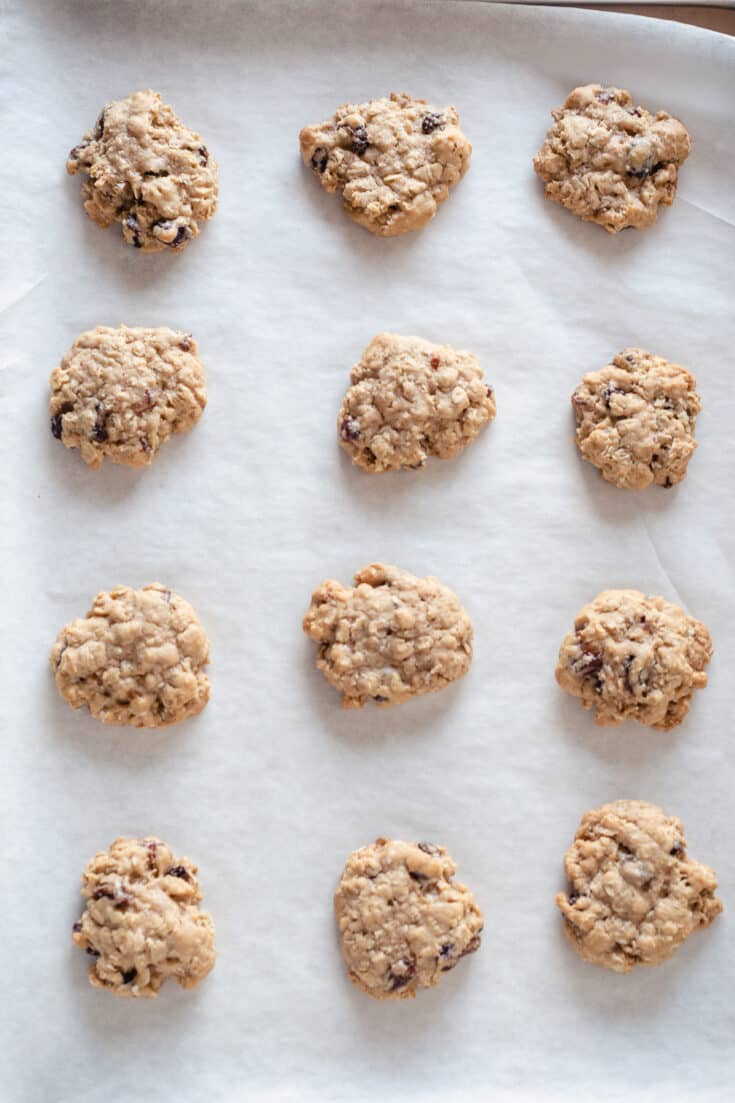 Soft and Chewy Oatmeal Raisin Cookies on parchment paper