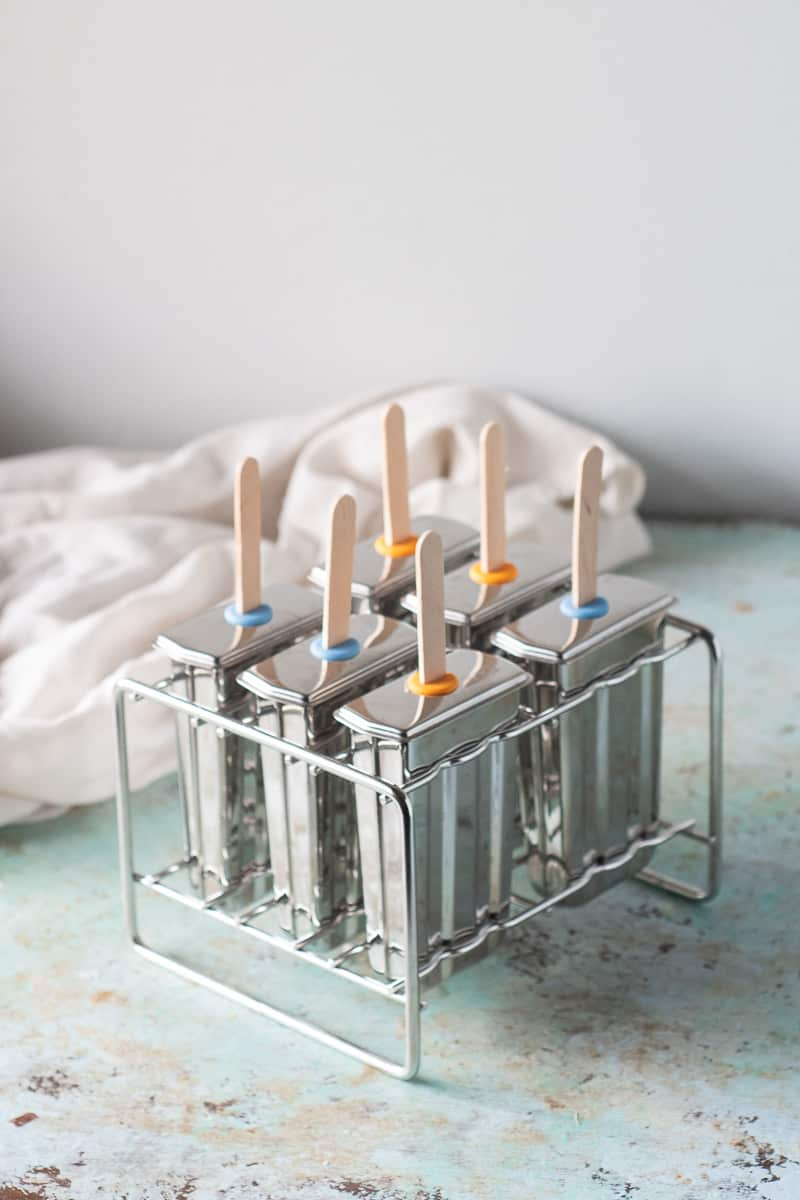 Popsicle molds with popsicle sticks